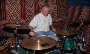 Simon Webster, drums, percussion, guitar, melodica and backing vocals.